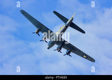 Sally B, B-17 Flying Fortress plane flying back from a display at the Bournemouth Air Festival 2018 - Stock Photo