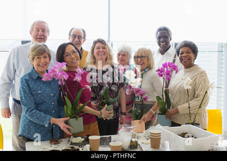 Portrait smiling active seniors enjoying flower arranging class - Stock Photo
