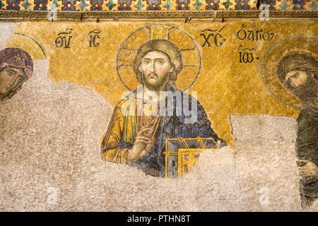 13th century Deisis mosaic panel depicting Christ in the Hagia Sophia upper gallery, Istanbul, Turkey - Stock Photo