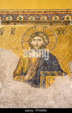13th century Deisis mosaic panel depicting Christ, the Virgin Mary and John the Baptist in the Hagia Sophia upper gallery, Istanbul, Turkey - Stock Photo