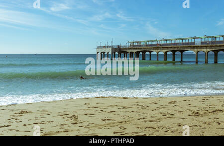 A view of Boscombe Pier in Bournemouth, UK. Waves breaking on the shoreline. Taken on 7th October 2018. - Stock Photo