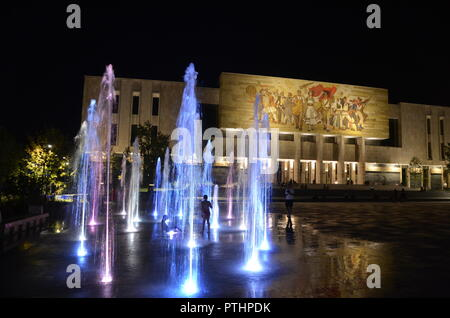 National Museum of History tirana albania at night with lit up coloured water fountains - Stock Photo