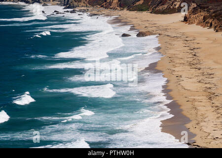Pacific ocean waves roll in at The private beach below the Point Sur lighthouse along Highway 1 in Big Sur, California. - Stock Photo