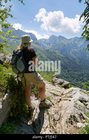Female hiker at a look out point from a trail around Col de la Forclaz looking towards La Tourneete France - Stock Photo