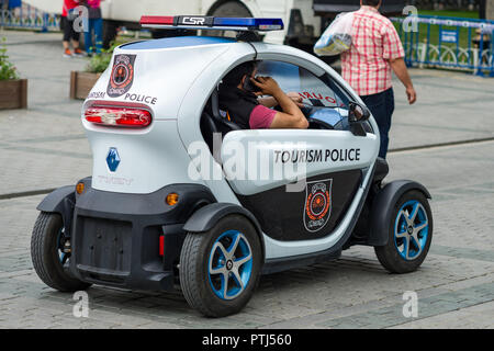 An all electric two seater Renault Twizy used as a tourism police vehicle with police officer in the car, Istanbul, Turkey - Stock Photo