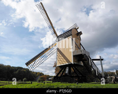 Old Dutch windmill of a specific type that is standing on a frame so the whole windmill can rotate photographed in the dutch open air museum in Arnhem - Stock Photo