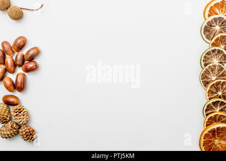 autumn composition with pine cones, slices of dried oranges and acorns, autumn concept, flat lay, top view - Stock Photo