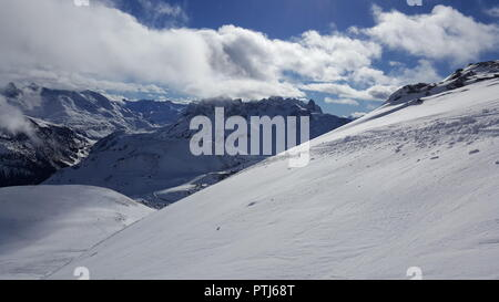 Image of ski resort in the winter with snow covered mountains and well prepared slops - Stock Photo