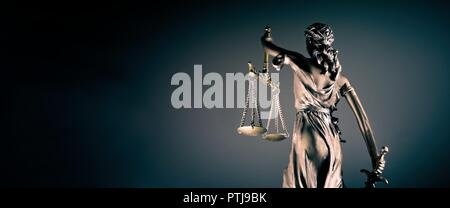 Statue of lady justice - rear view with copy space. - Stock Photo