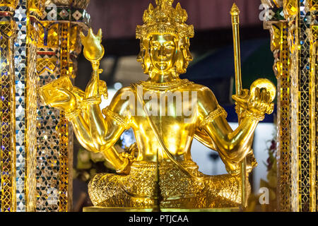 Phra Phrom statue at Erawan Shrine, Bangkok, Thailand. - Stock Photo