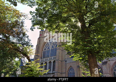 stained glass window on gothic building in bruges - Stock Photo