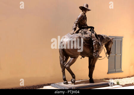 Yesterday is Tomorrow - cowboy on a horse sculpture in the Museum of Art courtyard in Tucson, AZ - Stock Photo