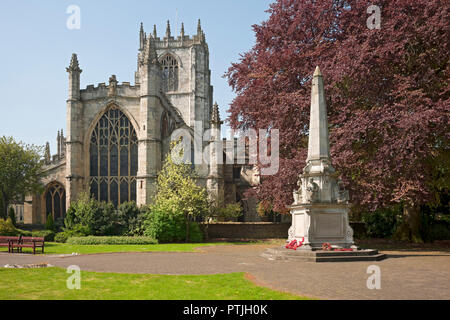 St Mary's Church and war memorial. - Stock Photo