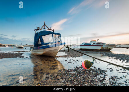 Boats on river Adur at low tide. - Stock Photo