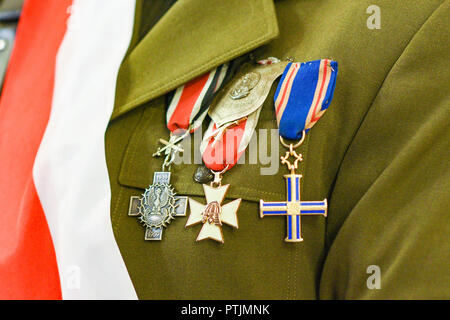 Military decorations on the uniform of the Polish army with the flag on the chest. - Stock Photo