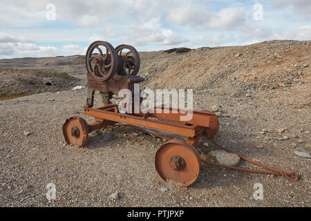 Old abandoned stone crusher equipment remains of the once thriving mining industry on Melbeck Moor, Gunnerside, Swaledale, Yorkshires Dales, UK - Stock Photo