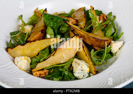 salad with gorgonzola cheese and pear - Stock Photo