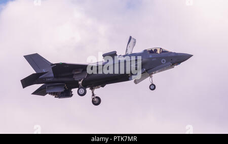 A British Lockheed Martin F-35 B Lightning II 5th generation multirole stealth fighter hovering on display flight at Duxford Air Show. - Stock Photo
