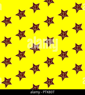 Seamless pattern of red star with hammer and sickle on the yellow background - Stock Photo