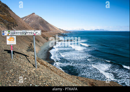 Djupavogshreppur, East coast Iceland. Beautiful views along Atlantic coast, mountain landscape and location signpost. - Stock Photo