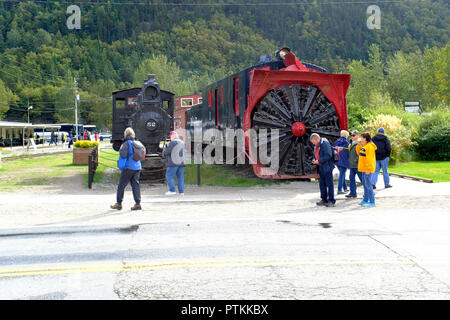 Railroad engines and cars near the train depot in Skagway, Alaska - Stock Photo