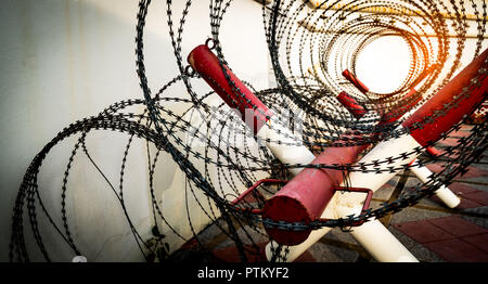 Barbed wire fence. Prison or jail wall. Security system. Private zone or danger military zone. Forbidden gate or entrance. Prohibited area. Red and wh - Stock Photo