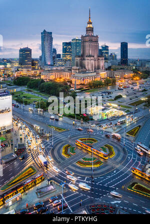 Warsaw Centrum, evening view of the very heart of the polish capital, with Rondo Dmowskiego roundabout, the Neomodern Warsaw Spire and the Russian Wed - Stock Photo