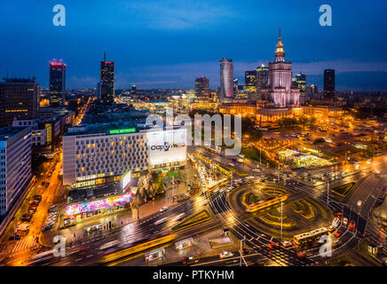 Warsaw Centrum, night view of the very heart of the polish capital, with Rondo Dmowskiego roundabout, the Neomodern Warsaw Spire and the Russian Wedin - Stock Photo
