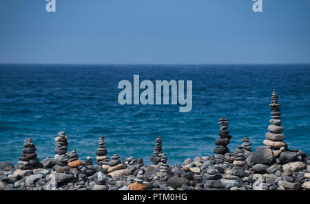 Cairns by the sea, Costa Adeje, Tenerife, Canary Islands, Spain - Stock Photo