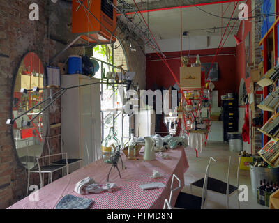 Dining room facing a garden in a a private house of a young artist in Milano, Italy - Stock Photo