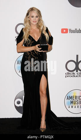Los Angeles, Ca, USA. 09th Oct, 2018. Carrie Underwood, winner of the Favorite Female Artist - Country award poses in the press room during the 2018 American Music Awards at Microsoft Theater on October 9, 2018 in Los Angeles, California. ( Credit: Image Space/Media Punch)/Alamy Live News - Stock Photo