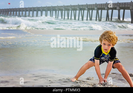Pensacola Beach, Florida, USA. 9th Oct 2018. Noah Majors, 7, makes sand castles at Pensacola Beach pier as waves from Hurricane Michael churn up the Gulf, Oct. 9, 2018, in Pensacola Beach, Florida. Although red flags warned visitors to stay out of the water, that didn't stop them from gathering on the beaches across the Florida Panhandle to enjoy the surf. Hurricane Michael is expected to make landfall in Panama City, Oct. 10, 2018, as a category four hurricane.  Credit: Carmen K. Sisson/Cloudybright/Alamy Live News - Stock Photo