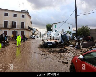 Sant Llorenc, Spain. 10th Oct, 2018. General view of te village of Sant Llorenc des Cardasar, in Mallorca island, eastern Spain, 10 October 2018, a day after the flash floods hitting the area. At least six people died and several other people are missing are due to the heavy rains which overflowed the torrent of Sant Llorenc. Some 300 members of emergency services take part in the search operation. Credit: Argentina Sanchez/EFE/Alamy Live News - Stock Photo
