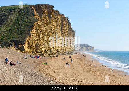 West Bay, Dorset, UK. 10th Oct, 2018. UK Weather. East beach and cliffs under clear blue sunny skies and very warm temperatures at the seaside resort of West Bay in Dorset. Picture Credit: Graham Hunt/Alamy Live News