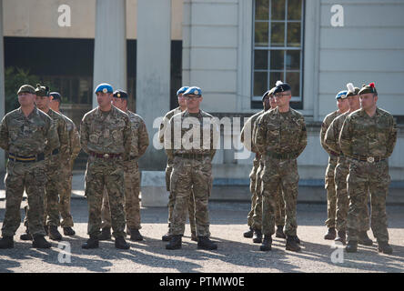 Westminster, London, UK. 10 October, 2018. The Army march to Parliament to be thanked by Parliament for service in not one theatre of operations, but in 55 countries and involves a contingent of 120 Army personnel – a distillation of the 51,726 soldiers who deployed last year to more than 55 countries on operations, defence engagement and training, and the 25,000 troops held in readiness to deploy at any moment. They arrive at Parliament accompanied by the world-famous Band of the Grenadier Guards in full ceremonial dress. Credit: Malcolm Park editorial/Alamy Live News - Stock Photo