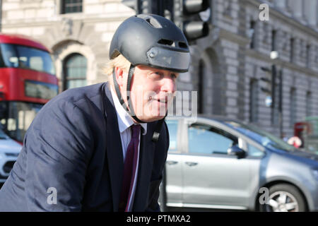 Parliament Square, London, UK. 10th Oct, 2018. Boris Johnson on his bicycle in Parliament Square. Penelope Barritt/Alamy Live News - Stock Photo