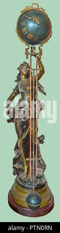 Antique figurine of standing woman in bronze holding orb pendulum clock on isolated green background with clipping path. - Stock Photo