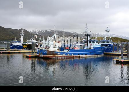 Big commercial fishing boats docked at a marina in Dutch Harbor, on Amaknak Island (Unalaska), in the Aleutian Islands chain, Alaska, United States. - Stock Photo