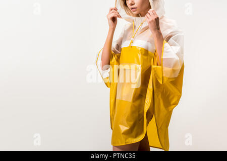 cropped image of woman in raincoat wearing hood isolated on white - Stock Photo