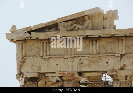 Greece. Athens. Acropolis. Parthenon. The Doric order. Architectural detail. Entablature: cornice (pediment and raking cornice), frieze (trygliphs and metopes), architrave and capitals (Abacus and echinus). 5th century BC. - Stock Photo