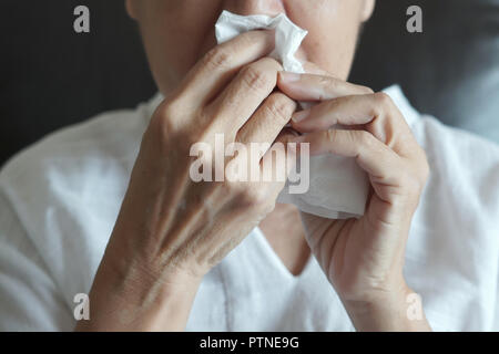 Elderly female robes feeling unwell just caught cold - Stock Photo