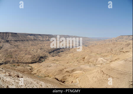 panoramic view from the King's Highway, which swoops over the high ridge of the Great Rift Valley. in Jordan - Stock Photo