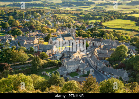 Corfe Village in Dorset, bathed in late afternoon sunshine as seen from East Hill - Stock Photo