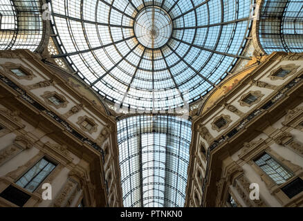 Close up of the ornate glass ceiling at Galleria Vittorio Emanuele II iconic 19th century shopping arcade, located next to the Cathedral in Milan - Stock Photo