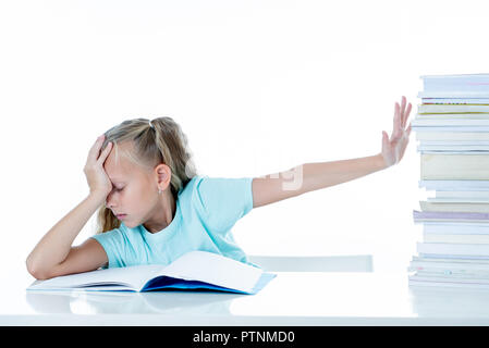 Beautiful school girl trying to study having too many homework that It's driving her crazy in motivation low performance children education concept is - Stock Photo