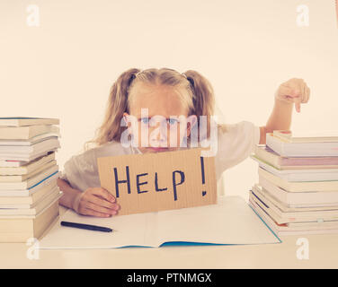 Sad tired and angry blonde school girl holding help sign in stress doing homework and studying with books in children education and low academic perfo - Stock Photo