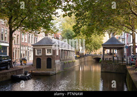 THE NETHERLANDS, GOUDA - OCTOBER 10, 2018: The historic fish market on the Hoge Gouwe canal. - Stock Photo