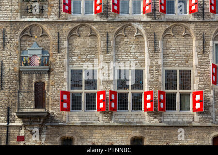 THE NETHERLANDS, GOUDA - OCTOBER 10, 2018: Detail of the facade of the famous gothic Town hall with it's colorful shutters. - Stock Photo