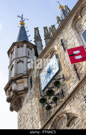 THE NETHERLANDS, GOUDA - OCTOBER 10, 2018: Detail of the facade of the famous gothic Town hall with it's colorfull shutters. - Stock Photo