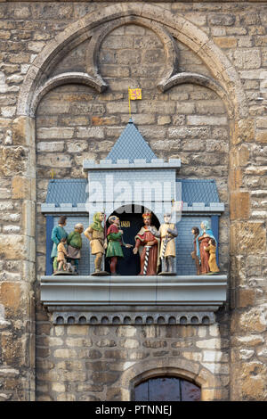 THE NETHERLANDS, GOUDA - OCTOBER 10, 2018: The puppet show enacting the moment the city got it's city rights, on the facade of the historic Town hall. - Stock Photo